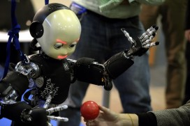 Humanoid robot iCub eyes a plastic ball as he is on display during the 2014 IEEE-RAS International Conference on Humanoid Robots in Madrid on November 19, 2014 (GERARD JULIEN/AFP/Getty Images)