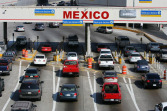 Cars wait to cross the US-Mexico border