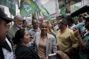 Brazilian presidential candidate for the Green Party Marina Silva is greeted by supporters as she campaigns in downtown Guarulhos