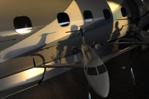 Visitors cast their shadows over a commercial jet made by Brazilian aircraft maker Embraer during the opening day of the Latin American business aviation fair