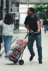 A man transports bottles of Coca Cola in a central street in Mexico City