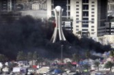 Bahrain: smoke billows from burning tents at Pearl roundabout March16