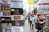 Shoppers walk past stalls at the 'ladies market' in Hong Kong
