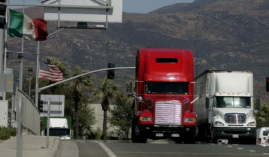 Trucks cross the US-Mexico border