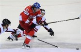 Jakub Voracek (C) of the Czech Republic fights for a puck with Mikelis Redlihs of Latvia during the IIHF Ice Hockey World Championships group D match in Bratislava,