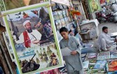 Peshawar, PAKISTAN: Posters of Al-Qaeda chief Osama bin Laden hang at a road side book stall in Peshawar, 23 September 2006.