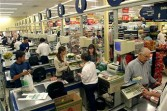 Cashiers ring up sales at a Pao de Acucar supermarket in Sao Paulo, Brazil, on Tuesday, April 20, 2004.