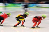 China's Yang Zhou (R), Germany's Aika Klein and Hungary's Erika Huszar compete in the Women's Short Track Speedskating 1000m heats at the Pacific Coliseum in Vancouver