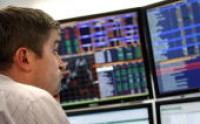 A Russian trader monitors the markets inside a private international investment banking firm in Moscow on October 9, 2008