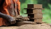 A Sri Lankan labour makes bricks by hand at a make-shift factory in Biyagamam, a suburb of the Sri Lankan capital Colombo, on July 17, 2011.