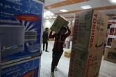 Iraqi man carries electrical goods