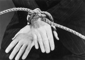 A man with his hands tied