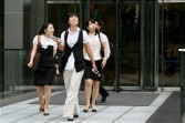 businesseswomen leave office in Seoul