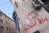 A Libyan electrician fixes a telephone line in Tripoli Oct 2011