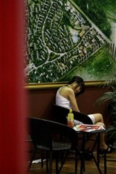 China property market slows. A saleswoman sits unoccupied at the 2010 Beijing Summer Real Estate Trade Fair