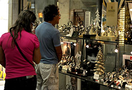 Shoppers in Brazil in front of a watch store