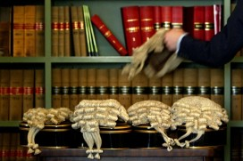 A barrister picks up his wig (Photo by Ian Waldie/Getty Images)