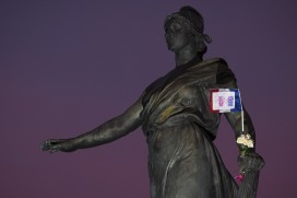 "A French national flag at the Paris statue ""Le triomphe de la Republique""  (Joel Saget/AFP/Getty Images)"