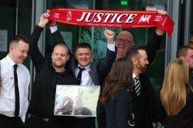 Relatives of the victims of the Hillsborough disaster celebrate the inquest verdict of unlawful killing