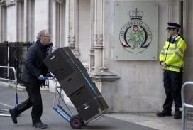 Cases of files arrive at the Supreme Court in London for the appeal hearing in December