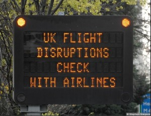 UK flight disruptions warning sign outside Heathrow airport - Steven Simpson