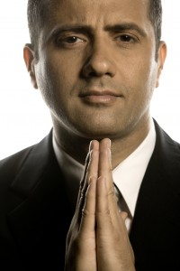 Man in suit praying