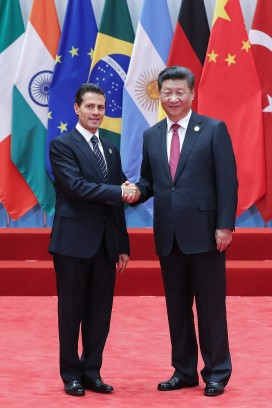 President Enrique Peña Nieto of Mexico (left ) and China's President Xi Jinping