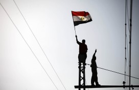 An Egyptian protester waves the national flag. MAHMUD KHALED/AFP/Getty Images