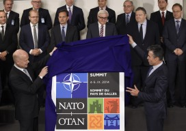 William Hague (L) and Nato Secretary General Anders Fogh Rasmussen unveil the logo of the Nato Wales' summit (JOHN THYS/AFP/Getty Images)