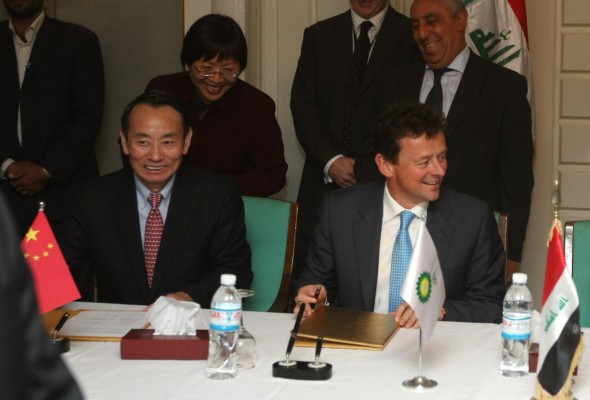 China's Jiang Jemin, the CEO of CNPC and Tony Hayward of BP smile after signing a major oil deal with Iraq in 2009 (AHMAD AL-RUBAYE/AFP/Getty Images)