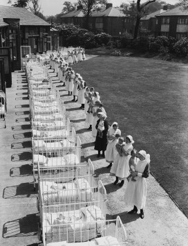 8th June 1939:  Babies in a row of cots brought out for some sun by their nurses at the Duchess of York's Hospital for Babies at Burnage, Manchester.  (Photo by Fox Photos/Getty Images)
