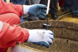 Sampling crude oil at well operated by Venezuela's state-owned oil company PDVSA