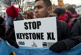 Opponents of the Keystone XL pipeline protest in Washington against Donald Trump's executive orders