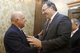 Iranian oil minister Bijan Zanganeh (left) shakes hands with Patrick Pouyanné, CEO of Total, after signing the deal