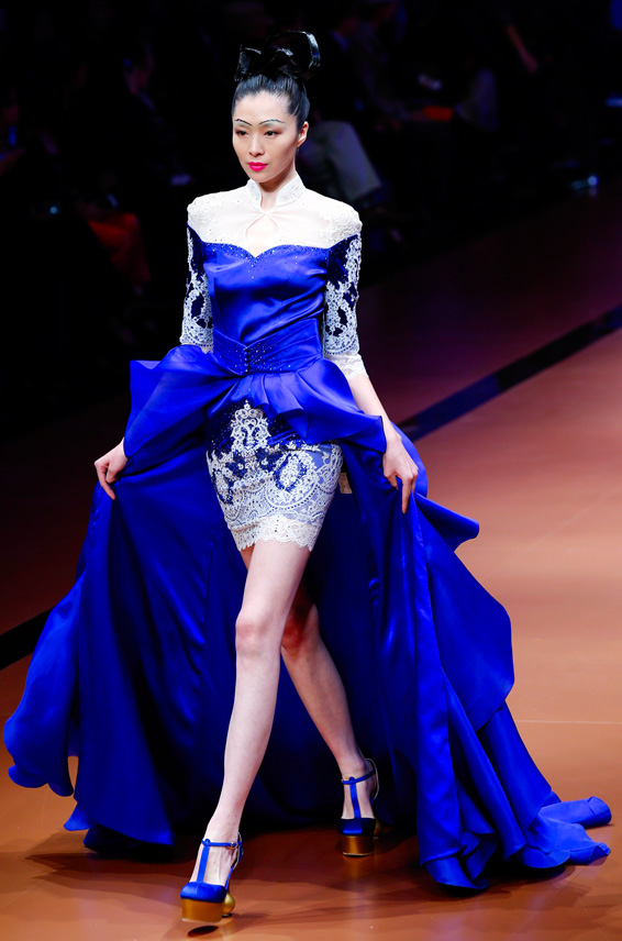 A model presents a creation from NE-TIGER Haute Couture Collection at China Fashion Week S/S 2014 in Beijing...A model presents a creation from NE-TIGER Haute Couture Collection at China Fashion Week S/S 2014 in Beijing, October 25, 2013.   REUTERS/Kim Kyung-Hoon (CHINA - Tags: FASHION)