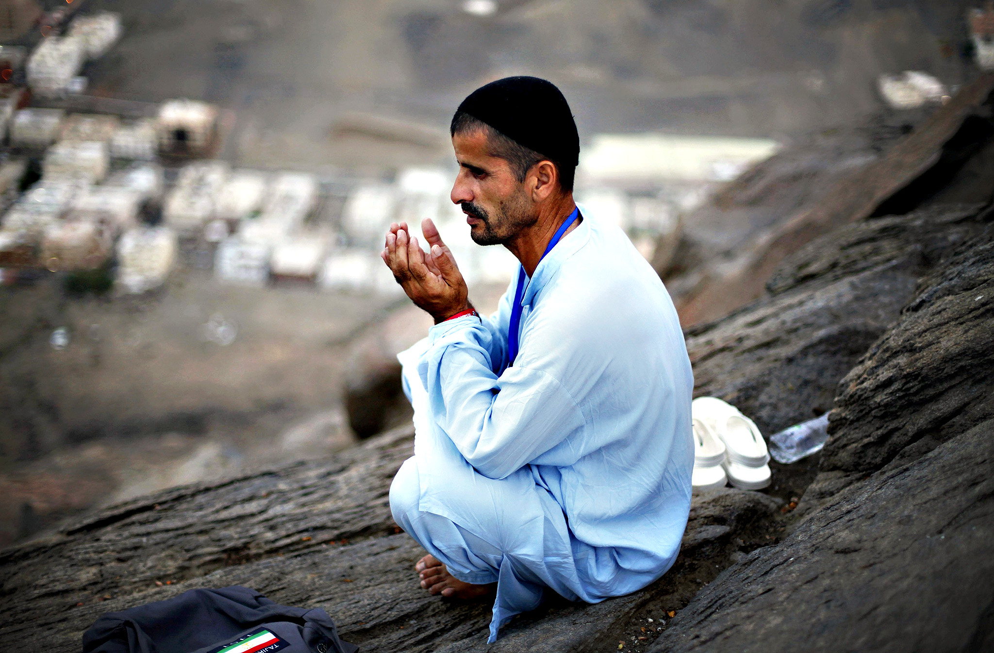 A Muslim pilgrim prays at Mount Al-Noor ahead of the annual haj pilgrimage in Mecca October 10, 2013. Mount Al-Noor houses Ghar-E-Hira or Hira cave, where Prophet Mohammad is said to have spent a great deal of time in the cave meditating and it is believed that he had received his first revelation inside this cave.