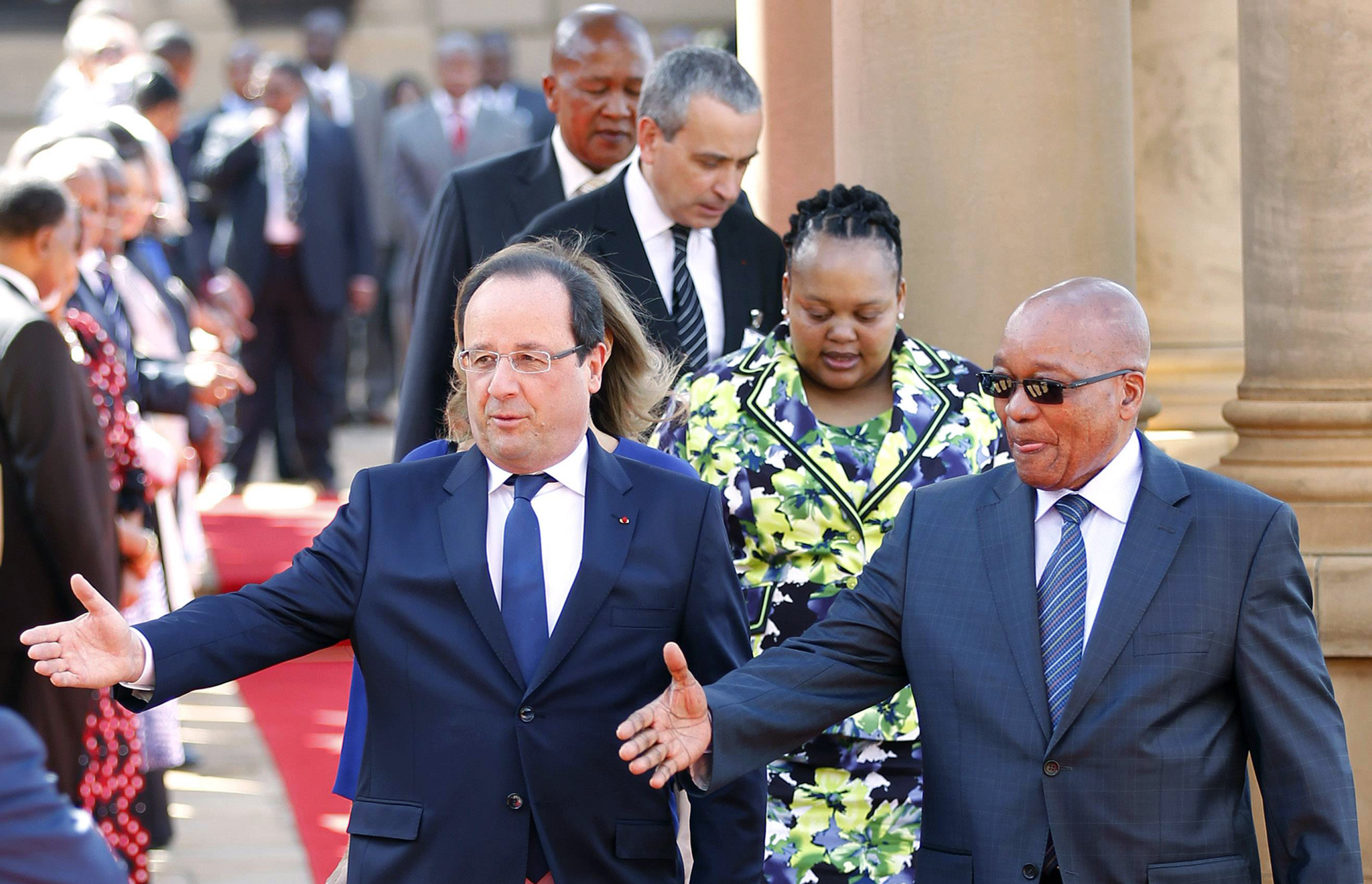 French President Francois Hollande introduces his delegation to South Africa's President Jacob Zuma at the Union Building in Pretoria...French President Francois Hollande (L) introduces his delegation to South Africa's President Jacob Zuma at the Union Building in Pretoria October 14, 2013. France will lend 100 million euros ($135 million) to South African state power utility Eskom to help it finance solar power projects in Africa's largest economy, according to a communique obtained by Reuters on Monday. The deal will be signed as a part of a summit between Hollande and Zuma, which started on Monday in Pretoria. REUTERS/Siphiwe Sibeko