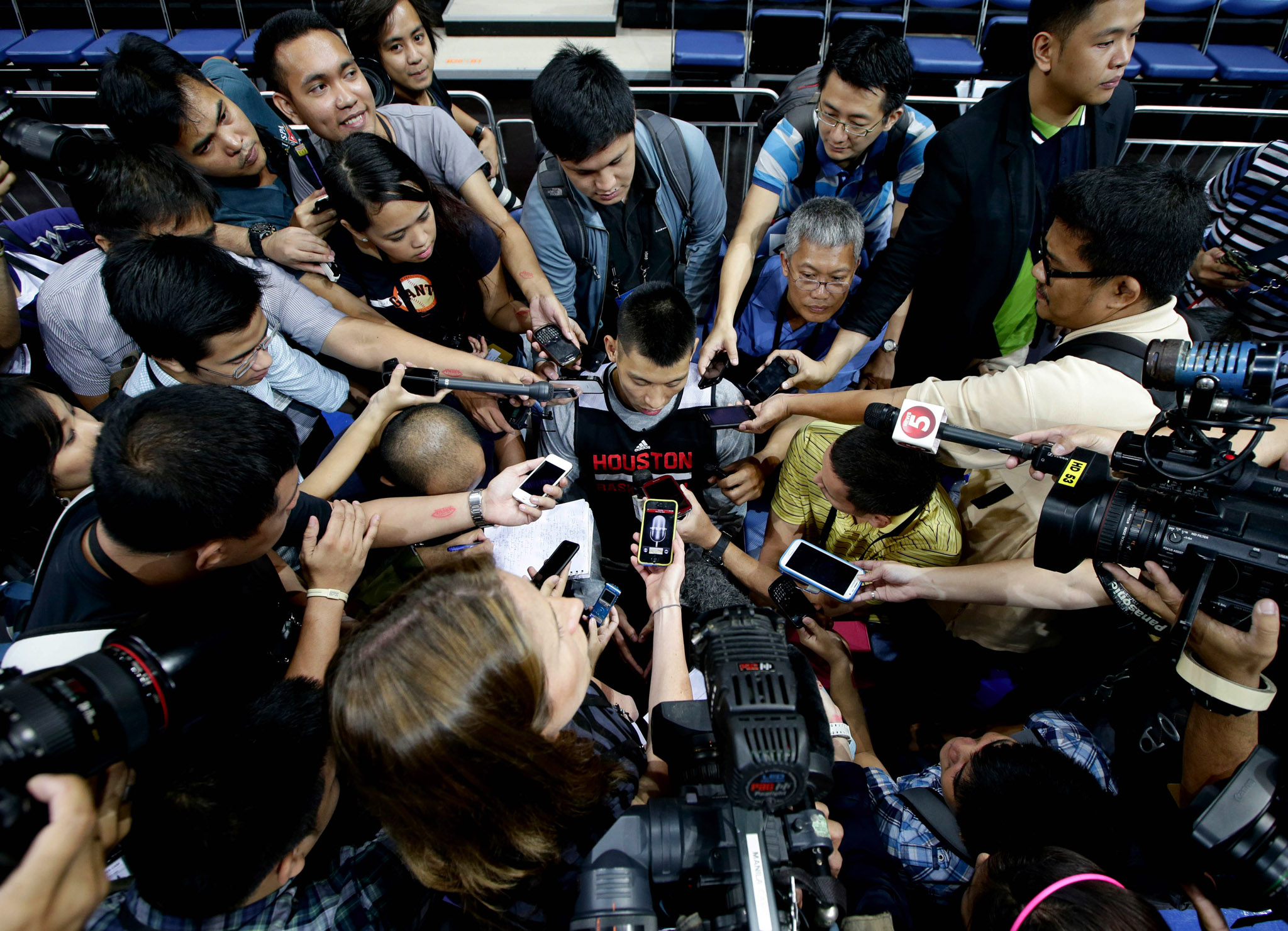 The Houston Rockets' Jeremy Lin is interviewed by a horde of reporters during a break in his team's practice at the Mall of Asia Arena at suburban Pasay city, south of Manila, Philippines. Lin has easily stolen the spotlight as the Houston Rockets practice for this week's first ever NBA preseason game against the Indiana Pacers in the basketball-obsessed Philippines.