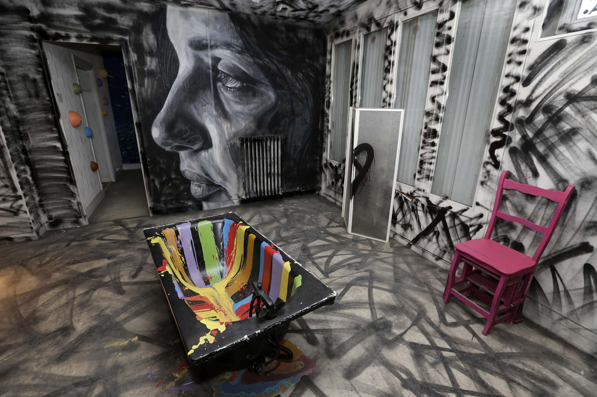 "A bathroom painted by British street artist David Walker is seen at the street art project tower ""Paris Tour 13"" in Paris."