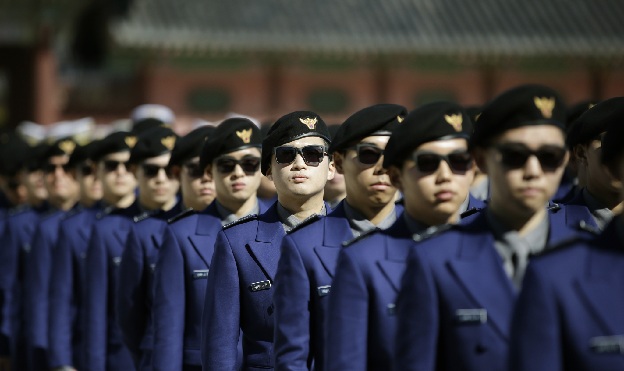 South Korean tourist police officers queue up for their inauguration ceremony near the Gwanghwamun, the main gate of the 14th-century Gyeongbok Palace and also one of South Korea's well known landmarks, in Seoul, South Korea, Wednesday, Oct. 16, 2013. South Korea unveiled its new tourist police force to protect foreign tourists during their stay in Seoul. (AP Photo/Lee Jin-man)