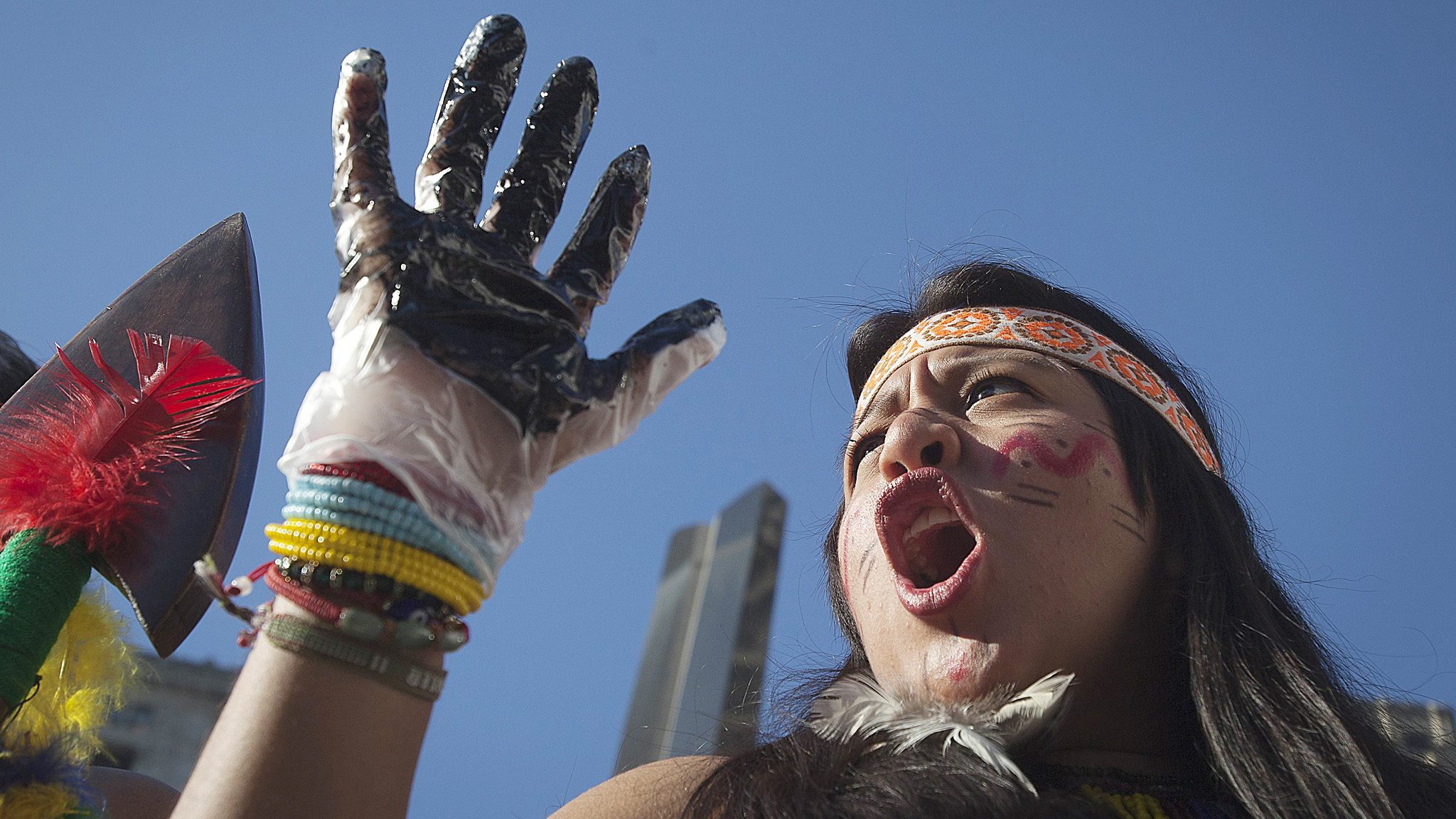 A protester from Ecuador holds up an oil covered hand as she demonstrates against Chevron's Racketeer Influenced and Corrupt Organizations trial in New York...A protester from Ecuador holds up an oil covered hand as she demonstrates against Chevron's Racketeer Influenced and Corrupt Organizations (RICO) trial in New York, October 15, 2013. Chevron Corp will try to convince a U.S. judge this week that a group of Ecuadorean villagers and their U.S. lawyer used bribery to win an $18 billion judgment against Chevron from a court in Ecuador, in the latest chapter in a long-running fight over pollution in the Amazon jungle. In a trial starting Tuesday, the oil company is asking a federal court in New York to prevent the villagers and their Harvard-educated lawyer, Steven Donziger, from using U.S. courts to enforce the Ecuadorean judgment.  REUTERS/Carlo Allegri (UNITED STATES -