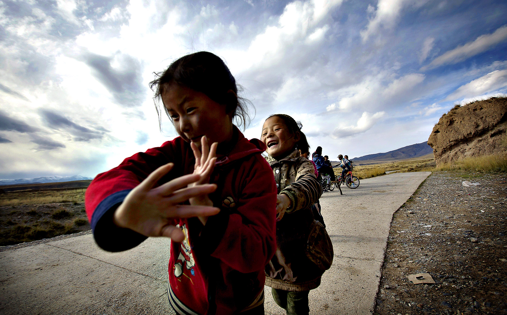 Tibetan children play near Bajiao village in the Ganjia Grasslands on the outskirts of Xiahe, Gansu Province, China Thursday, Oct. 17, 2013. Bajiao village, known as Karnang in Tibetan, is an ancient village, which is believed to be roughly 2,000 years old and is surrounded by a 12-sided city wall.