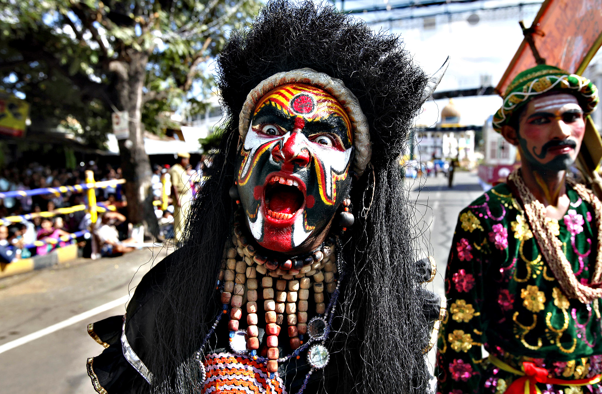 An Indian artist dressed as a devil gestures to the camera during a procession on the last day of Dusshera celebrations in Mysore, India, Monday, Oct. 14, 2013. According to Hindu mythology the festival celebrates the slaying of the demon Mahishasura by the goddess Chamundeeswari or Durga and the triumph of good over evil.