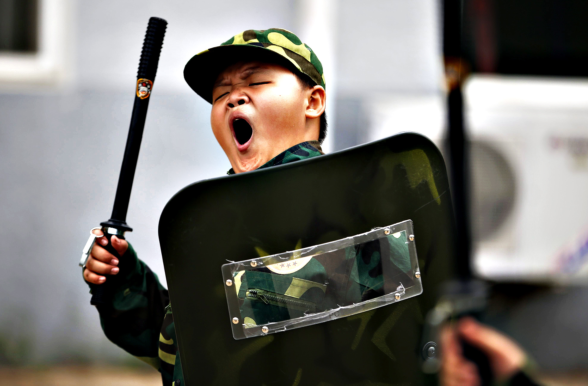 A young boy yawns during early morning self defense training at a summer boot camp on the outskirts of Beijing, China. Running in its fifth year, the youth military summer camp first opened in 2008, when it only had a handful of students signed up. Today the camp caters to over 2,000 kids a year over a two month period. The camp is ran mainly by former military, police, and fire fighters, looking after kids ranging from 6 to 17 years of age, with 70 percent being boys and 30 percent girls.