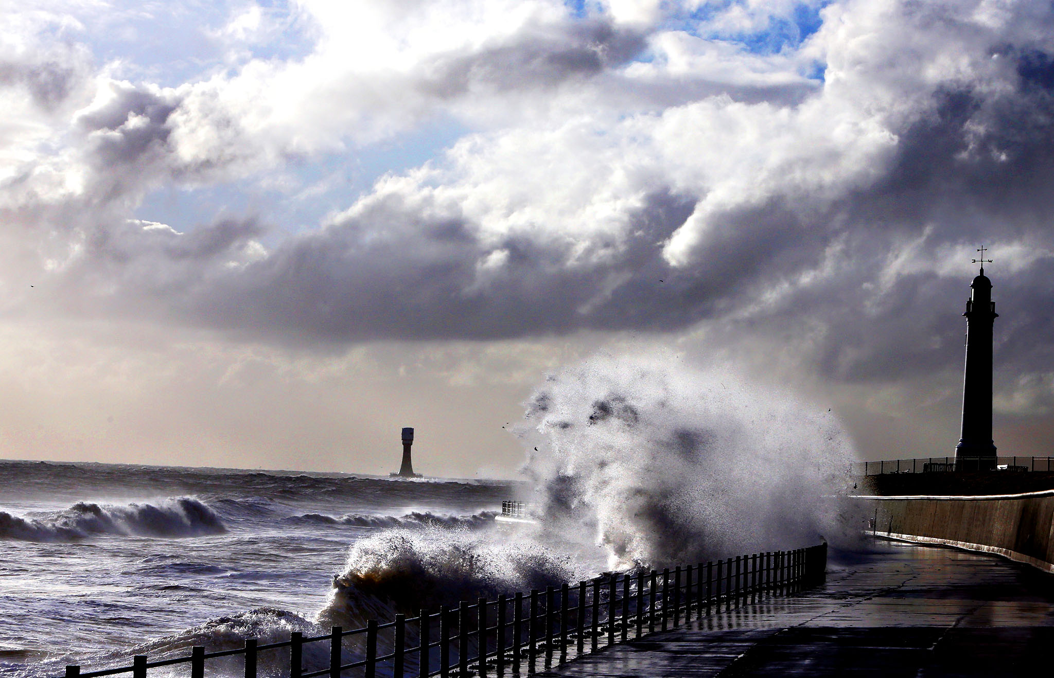 Heavy seas and waves crash over the seafront promenade at Seaburn, England, Thursday. The Environment Agency has issued flood warnings for low lying roads and coastal land along the North East coastline.