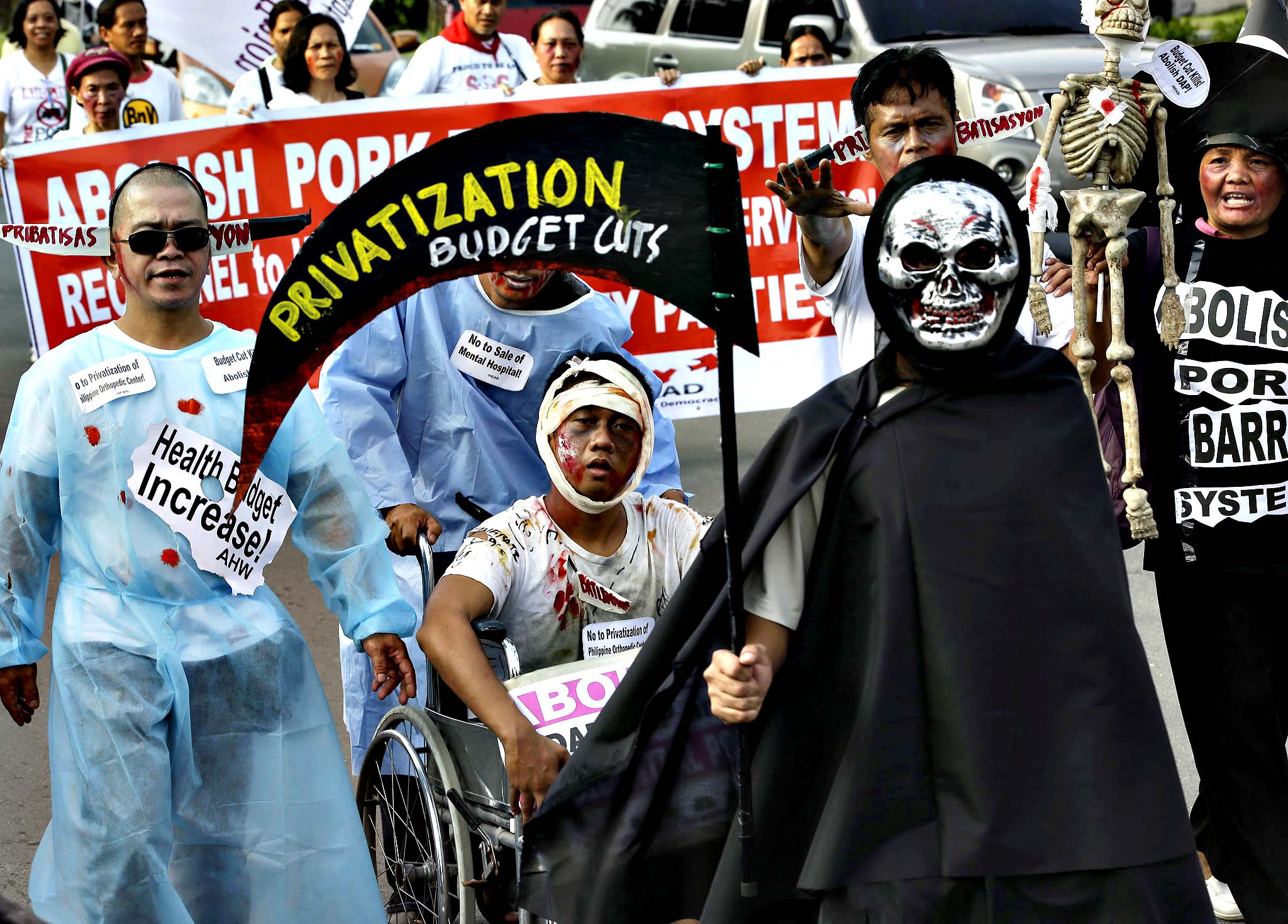 "Protesters, some dressed in their Halloween costumes, march towards the Philippine Senate to demand the scrapping of the government funds intended for development projects by lawmakers known as ""Pork Barrel"" fund Wednesday Oct. 23, 2013 at suburban Pasay city, south of Manila, Philippines. The ""Pork Barrel"" scandal was exposed following the surrender of Janet Lim Napoles, a wealthy businesswoman who allegedly stole huge amounts of government development funds in conspiracy with powerful lawmakers. Napoles is set to appear before the Senate Blue Ribbon Committee on Nov. 7."
