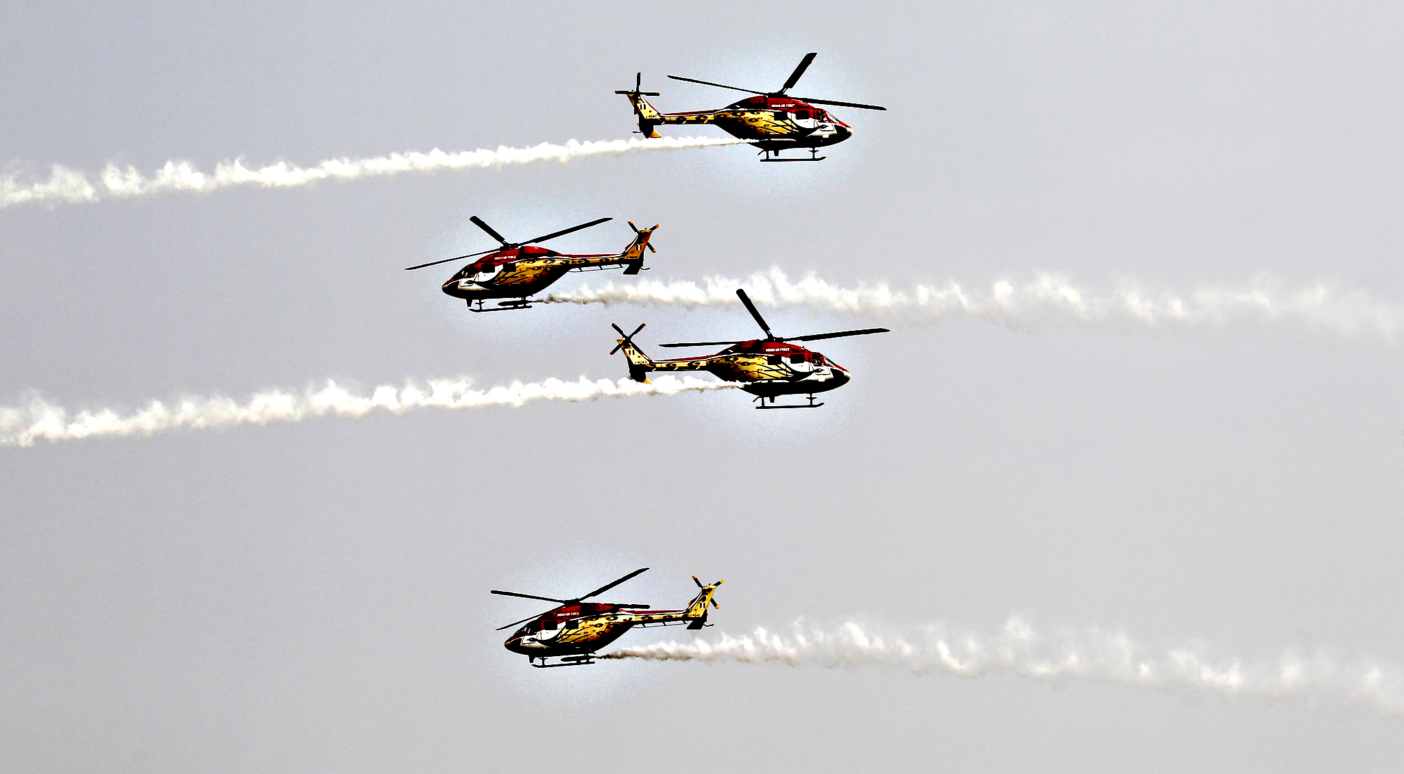 "Indian Air Force ""Sarang"" helicopter display team performs during the Indian Air Force Day celebrations at the Hindon air force station on the outskirts of New Delhi...Indian Air Force ""Sarang"" helicopter display team performs during the Indian Air Force Day celebrations at the Hindon air force station on the outskirts of New Delhi October 8, 2013. The IAF celebrated its 81st anniversary on Tuesday."