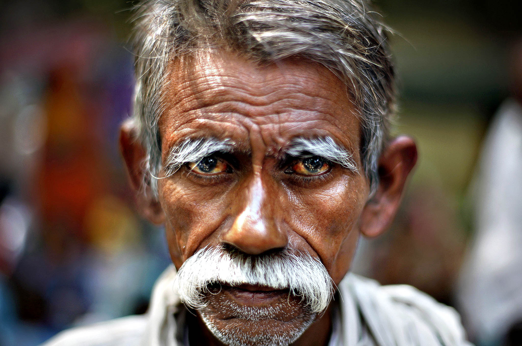 Baba Din, an elderly member of India's landless, poor farmers and the tribal community, listens to a speaker during a protest at Jantar Mantar, an area near the Indian parliament where citizens from across the country assemble for protests, in New Delhi, India, Thursday, Oct. 3, 2013. The farmers were protesting against government procuring land for setting up industry and not providing enough subsidy to farmers among several other grievances.