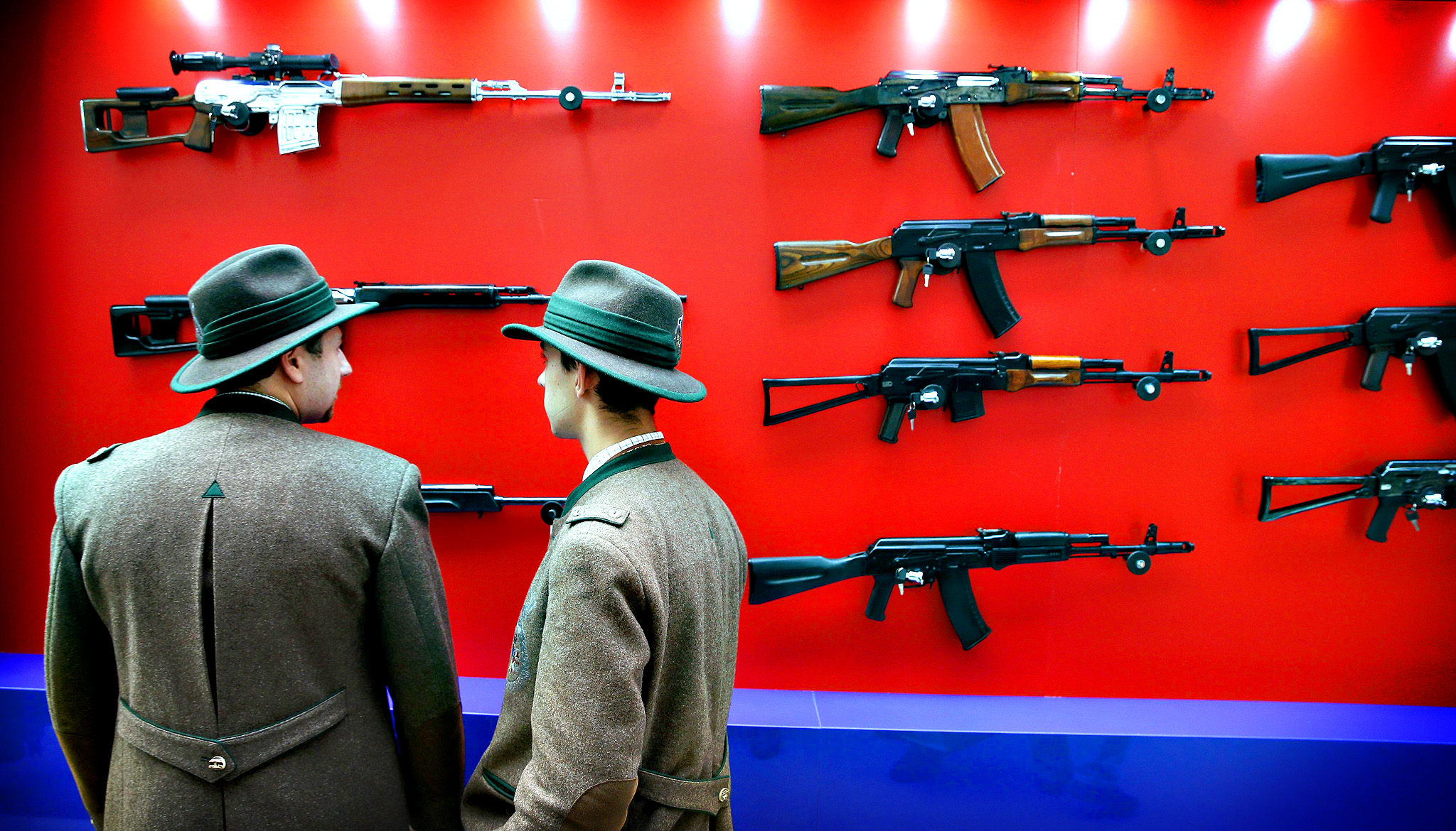 Visitors look at Kalashnikov automatic rifles during the Arms and Hunting Exhibition in Moscow, Russia, 10 October 2013. The exhibition that runs from 10 to 13 October 2013.