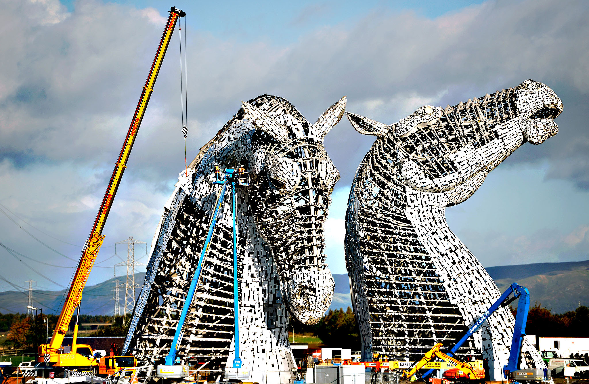 Work continues on The Kelpies sculptures at the eastern entrance to the Forth and Clyde canal on October 10, 2013 in Falkirk, Scotland. The two Kelpie heads are positioned at a specially constructed canal lock and basin part of the Helix project, each weighing 300 tonnes and standing 100 feet tall. The structure was designed by sculptor Andy Scott as a monument to horse powered heritage across Central Scotland.